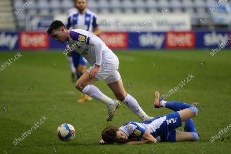 Wigan's Tom Pearce beaten by Shrewsbury Town's Matthew Millar during the EFL Sky Bet League 1 match between Wigan Athletic and Shrewsbury Town at the DW Stadium, Wigan