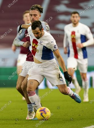 Jack Grealish (L) of Aston Villa in action against Luka Milivojevic (R) of Crystal Palace during the English Premier League soccer match between Aston Villa and Crystal Palace in Birmingham, Britain, 26 December 2020.