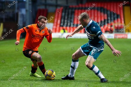 Paul McMullan (#7) of Dundee United takes on Liam Grimshaw (#2) of Motherwell during the Scottish Premiership match between Dundee United and Motherwell at Tannadice Park, Dundee