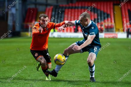Stock Picture of Paul McMullan (#7) of Dundee United takes on Liam Grimshaw (#2) of Motherwell during the Scottish Premiership match between Dundee United and Motherwell at Tannadice Park, Dundee