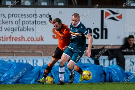 Liam Grimshaw (#2) of Motherwell defends the ball from the challenge of Paul McMullan (#7) of Dundee United during the Scottish Premiership match between Dundee United and Motherwell at Tannadice Park, Dundee