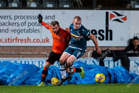 Stock Image of Liam Grimshaw (#2) of Motherwell defends the ball from the challenge of Paul McMullan (#7) of Dundee United during the Scottish Premiership match between Dundee United and Motherwell at Tannadice Park, Dundee