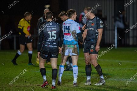 Josh Adams of Cardiff Blues and Jamie Roberts of Dragons shake hands at the final whistle