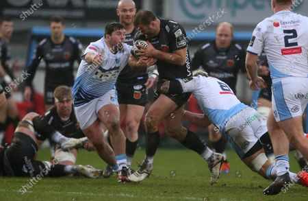 Jamie Roberts of Dragons is tackled by Brad Thyer and Josh Turnbull of Cardiff Blues.
