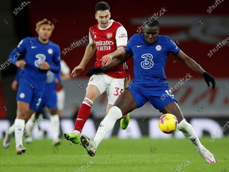 Chelsea's Kurt Zouma, right defend the ball from Arsenal's Gabriel Martinelli during their English Premier League soccer match between Arsenal and Chelsea at the Emirates stadium in London