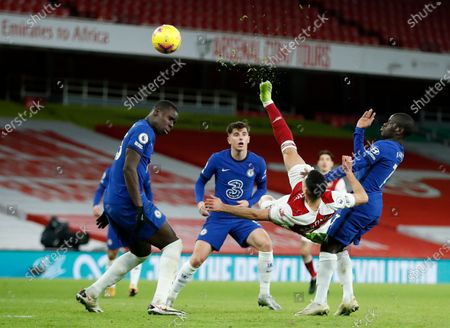 Arsenal's Gabriel Martinelli, center, attempts an over head kick at goal during their English Premier League soccer match between Arsenal and Chelsea at the Emirates stadium in London