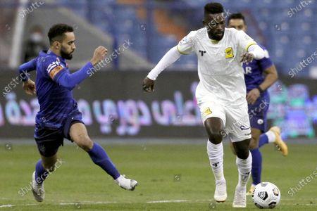 Stock Image of Al-Hilal's player Mohammed Al-Burayk (L) in action against Al-Ittihad's Abdulaziz Al-Bishi (R) during the Saudi Professional League soccer match between Al-Hilal and Al-Ittihad at King Fahd International Stadium, in Riyadh, Saudi Arabia, 26 December 2020.