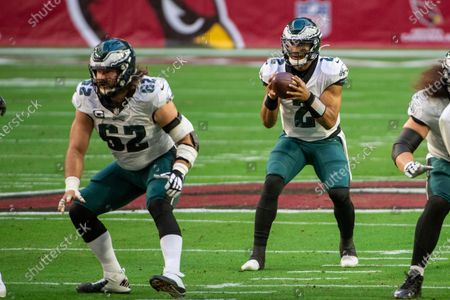 Philadelphia Eagles center Jason Kelce (62) snaps the ball to quarterback Jalen Hurts (2) during an NFL football game against the Arizona Cardinals, in Glendale, Ariz