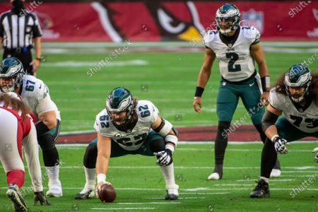 Philadelphia Eagles center Jason Kelce (62) prepares to snap the ball to quarterback Jalen Hurts (2) during an NFL football game against the Arizona Cardinals, in Glendale, Ariz