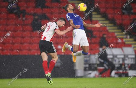 Jack Robinson (L) of Sheffield in action against Dominic Calvert-Lewin of Everton during the English Premier League soccer match between Sheffield United and Everton FC in Sheffield, Britain, 26 December 2020.