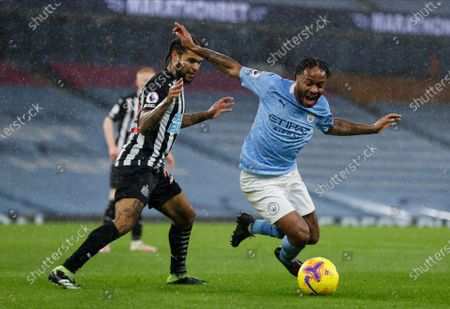 Manchester City's Raheem Sterling, right, and Newcastle's DeAndre Yedlin challenge for the ball during the English Premier League soccer match between Manchester City and Newcastle United at the Etihad Stadium in Manchester, England, Saturday, Dec., 26, 2020