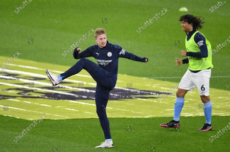 Manchester City's Kevin De Bruyne (L) and Nathan Ake (R) in action during the warm-up ahead of the English Premier League soccer match between Manchester City and Newcastle United in Manchester, Britain, 26 December 2020.