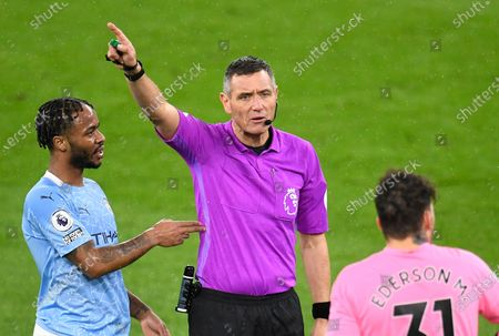 Manchester City's Raheem Sterling (L) talks to referee Andre Marriner (R) during the English Premier League soccer match between Manchester City and Newcastle United in Manchester, Britain, 26 December 2020.