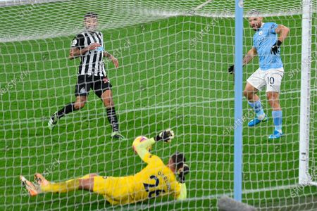 Manchester City's Sergio Aguero (R) in action against Newcastle goalkeeper Karl Darlow (down) during the English Premier League soccer match between Manchester City and Newcastle United in Manchester, Britain, 26 December 2020.