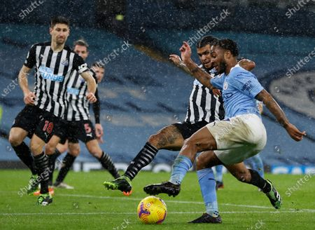 Manchester City's Raheem Sterling (R) in action against Newcastle's DeAndre Yedlin (L) during the English Premier League soccer match between Manchester City and Newcastle United in Manchester, Britain, 26 December 2020.