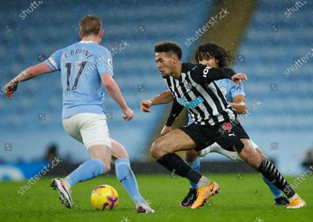 Newcastle's Joelinton (C) in action against Manchester City's Kevin De Bruyne (L) and Nathan Ake (R) during the English Premier League soccer match between Manchester City and Newcastle United in Manchester, Britain, 26 December 2020.