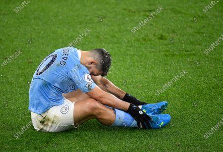 Stock Image of Manchester City's Sergio Aguero after taking a tumble during the English Premier League soccer match between Manchester City and Newcastle United at the Etihad stadium in Manchester