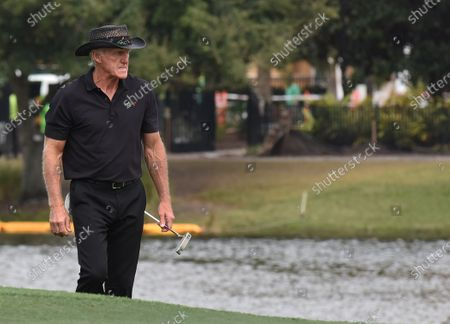 Australian Greg Norman approaches the 18th green during the final round at the PNC Championship golf tournament at the Ritz-Carlton Golf Club.  On Christmas Day, Norman posted a photo on Instagram from a hospital bed where he was being treated for COVID-19 symptoms. Norman's son also posted a photo on Instagram, stating that he and his fiancée have tested positive for the COVID-19 virus.