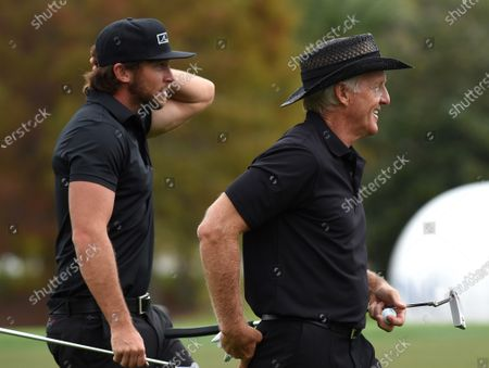 Australian Greg Norman (r) and his son, Greg Norman Jr. prepare to putt on the 18th green during the final round at the PNC Championship golf tournament at the Ritz-Carlton Golf Club.  On Christmas Day, Norman posted a photo on Instagram from a hospital bed where he was being treated for COVID-19 symptoms. Norman's son also posted a photo on Instagram, stating that he and his fiancée have tested positive for the COVID-19 virus.