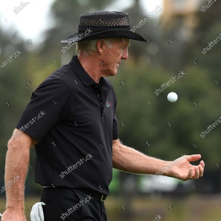 Australian Greg Norman bounces a golf ball in his hand after finishing the final round at the PNC Championship golf tournament at the Ritz-Carlton Golf Club.  On Christmas Day, Norman posted a photo on Instagram from a hospital bed where he was being treated for COVID-19 symptoms. Norman's son also posted a photo on Instagram, stating that he and his fiancée have tested positive for the COVID-19 virus.