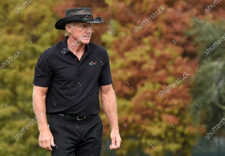Australian Greg Norman walks the 18th green during the final round at the PNC Championship golf tournament at the Ritz-Carlton Golf Club.  On Christmas Day, Norman posted a photo on Instagram from a hospital bed where he was being treated for COVID-19 symptoms. Norman's son also posted a photo on Instagram, stating that he and his fiancée have tested positive for the COVID-19 virus.