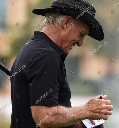 Australian Greg Norman fills out his scorecard  after finishing the final round at the PNC Championship golf tournament at the Ritz-Carlton Golf Club.  On Christmas Day, Norman posted a photo on Instagram from a hospital bed where he was being treated for COVID-19 symptoms. Norman's son also posted a photo on Instagram, stating that he and his fiancée have tested positive for the COVID-19 virus.