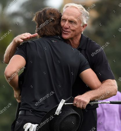 Australian Greg Norman (r) and his son, Greg Norman Jr. embrace after completing the final round at the PNC Championship golf tournament at the Ritz-Carlton Golf Club.  On Christmas Day, Norman posted a photo on Instagram from a hospital bed where he was being treated for COVID-19 symptoms. Norman's son also posted a photo on Instagram, stating that he and his fiancée have tested positive for the COVID-19 virus.