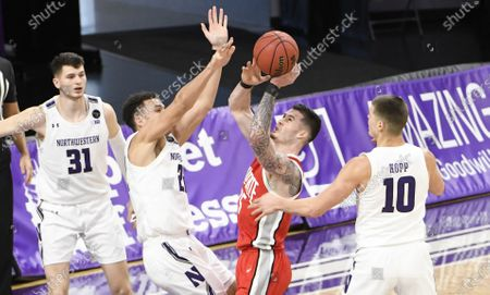 Northwestern forward Pete Nance (22) defends Ohio State forward Kyle Young (25) during the second half of an NCAA college basketball game, in Evanston, Ill