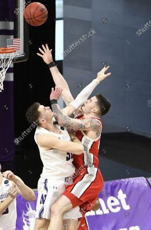Northwestern forward Robbie Beran, left, defends Ohio State forward Kyle Young, right, during the second half of an NCAA college basketball game, in Evanston, Ill