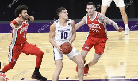 Northwestern forward Miller Kopp (10) drives to the basket as Ohio State forward Kyle Young (25) guards him during the second half of an NCAA college basketball game, in Evanston, Ill