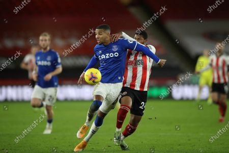 Sheffield United's Rhian Brewster, center right, and Everton's Mason Holgate, center left, fight for the ball during the English Premier League soccer match between Sheffield United and Everton at the Bramall Lane stadium in Sheffield, England