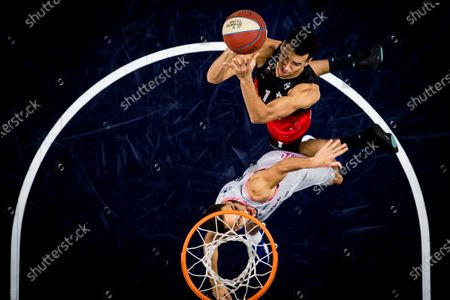 Spirou's Noah Fogang and Brussels' William Robeyns fight for the ball during the basketball match between Phoenix Brussels and Spirou Charleroi, Saturday 26 December 2020 in Brussels, on the sixth day of the 'EuroMillions League' Belgian first division basket championships, in the group A.
