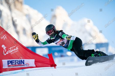 Stock Picture of CARRIGAN Maggie Rose competing in the Fis Snowboard World Cup 2021 Women's Parallel Giant Slalom on the Tondi Normale (Faloria) Course in the dolomite mountain range.
