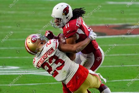 Arizona Cardinals wide receiver Larry Fitzgerald (11) makes a catch as San Francisco 49ers cornerback Ahkello Witherspoon (23) defends during the second half of an NFL football game, in Glendale, Ariz