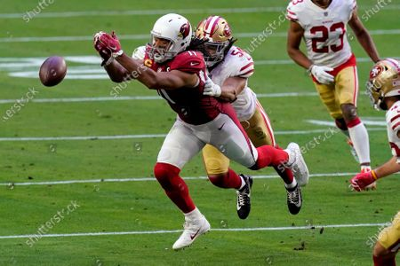 Arizona Cardinals wide receiver Larry Fitzgerald (11) can't hold on as San Francisco 49ers middle linebacker Fred Warner (54) defends during the first half of an NFL football game, in Glendale, Ariz