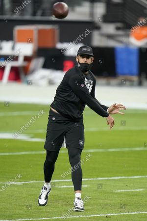 Las Vegas Raiders quarterback Marcus Mariota #8 warms up prior to playing the Miami Dolphins in an NFL football game, in Las Vegas