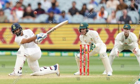 Hanuma Vihari (L) of India hits the ball in the air and is caught out by Steven Smith (R) of Australia during day two of the second Test Match between Australia and India at The MCG, Melbourne, Australia, 27 December 2020.