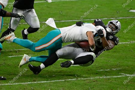 Stock Picture of Las Vegas Raiders defensive tackle Johnathan Hankins (90) sacks Miami Dolphins quarterback Tua Tagovailoa (1) during the second half of an NFL football game, in Las Vegas