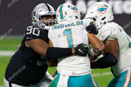 Las Vegas Raiders defensive tackle Johnathan Hankins (90) sacks Miami Dolphins quarterback Tua Tagovailoa (1) during the second half of an NFL football game, in Las Vegas