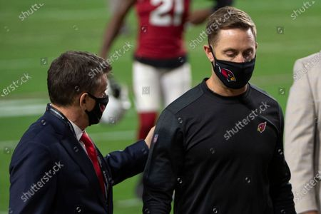 Arizona Cardinals owner Michael Bidwill talks with head coach Kliff Kingsbury after the NFL football game against the San Francisco 49ers, in Glendale, Ariz