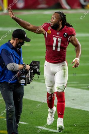 Arizona Cardinals wide receiver Larry Fitzgerald (11) waves to the stands after an NFL football game against the San Francisco 49ers, in Glendale, Ariz