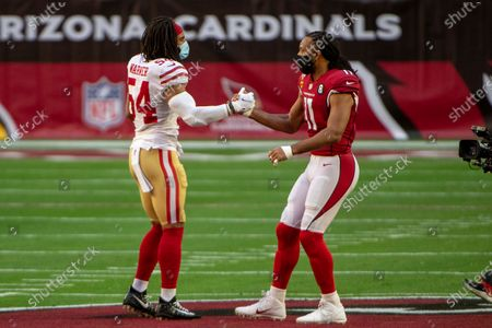 San Francisco 49ers middle linebacker Fred Warner (54) and Arizona Cardinals wide receiver Larry Fitzgerald (11) shake hands during an NFL football game, in Glendale, Ariz