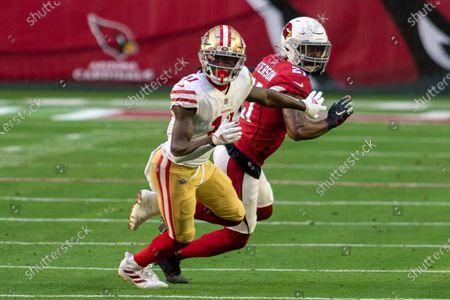 San Francisco 49ers wide receiver Brandon Aiyuk (11) battles with Arizona Cardinals cornerback Patrick Peterson (21) during an NFL football game, in Glendale, Ariz