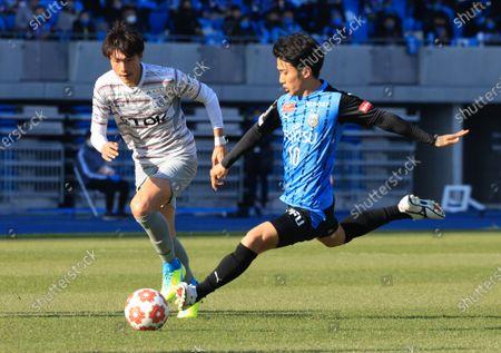 Stock Image of , Tokyo, Japan - Kawasaki Frontale midfielder Ryota Oshima (R) shoots the ball against Blaubritz Akita at the Emperor's Cup football tournament semi finals in Kawaski, suburban Tokyo on Sunday, December 27, 2020. Kawasaki defeated Akita 2-0.