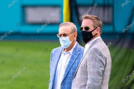 Stock Picture of From left, Miami Dolphins Chairman of the Board/Managing General Partner Stephen Ross and Miami Dolphins Vice Chairman, President and Chief Executive Officer Tom Garfinkel wear masks on the sidelines before the Dolphins take on the New England Patriots during an NFL football game, in Miami Gardens, Fla