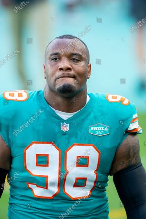 Stock Picture of Miami Dolphins defensive tackle Raekwon Davis (98) on the field before the Dolphins take on the New England Patriots during an NFL football game, in Miami Gardens, Fla