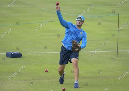 Stock Photo of South African head coach Mark Boucher throws the ball during the pre-warmup on day two of the first cricket test match between South Africa and Sri Lanka at Super Sport Park Stadium in Pretoria