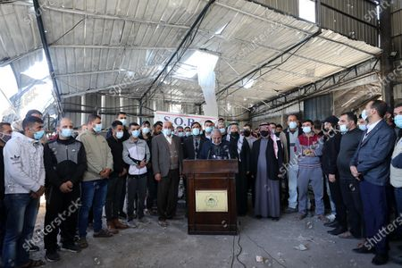 Senior Hamas leader Mahmoud al-Zahar, speaks during a press conference from inside the damaged factories following Israeli airstrikes on Gaza City, on December 27, 2020, Israel targeted a number of sites in Gaza after Palestinian militants fired rockets into the south of the country.