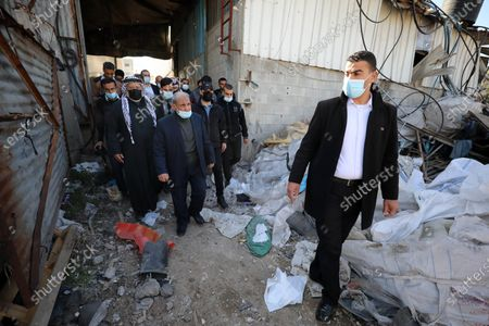 Senior Hamas leader Mahmoud al-Zahar, inspects damaged factories following Israeli airstrikes on Gaza City, on December 27, 2020, Israel targeted a number of sites in Gaza after Palestinian militants fired rockets into the south of the country.