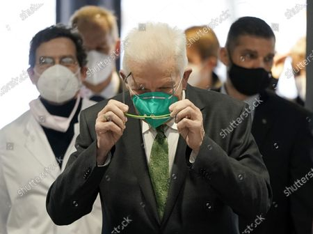 Stock Photo of Prime Minister of Baden-Wuerttemberg state Winfried Kretschmann arrives for his visit of the vaccination center in the Liederhalle in Stuttgart, Germany, Germany, 27 December 2020. Due to the COVID 19 pandemic caused by the SARS CoV-2 coronavirus, vaccination against the coronavirus has now started across the country.